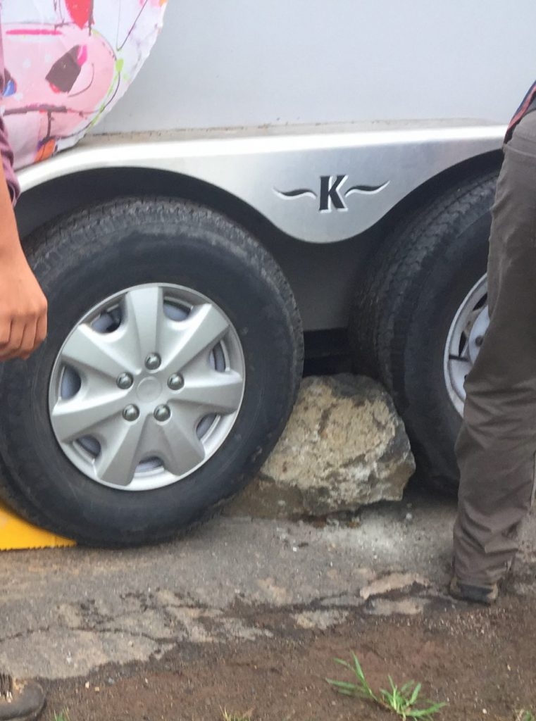tire wedged between rear wheels of horse trailer