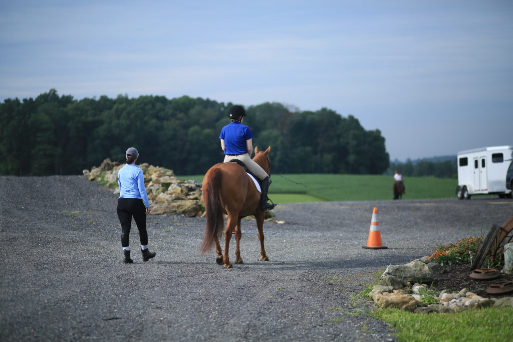 Jessica and Melissa Smith head to the warmup area before Lucy's first ever live judged dressage class
